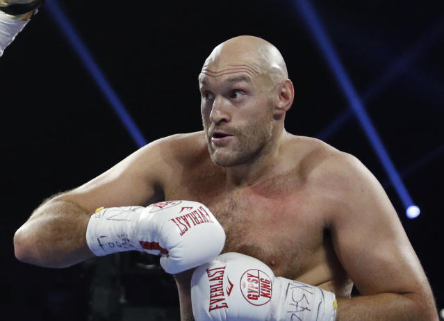 FILE - In this file photo dated Saturday, June 15, 2019, Tyson Fury, of England in action against Tom Schwarz of Germany, in Las Vegas, USA. Tyson Fury has changed trainers just two months before his likely heavyweight rematch with WBC champion Deontay Wilder, it is revealed Monday Dec. 16, 2019. (AP Photo/John Locher, FILE)