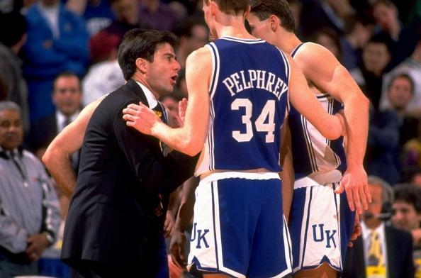 Kentucky coach Rick Pitino talking to John Pelphrey (34) and teammates during the Wildcats' loss to Duke at The Spectrum in Philadelphia – March 28, 1992. (Getty file photo) <br>