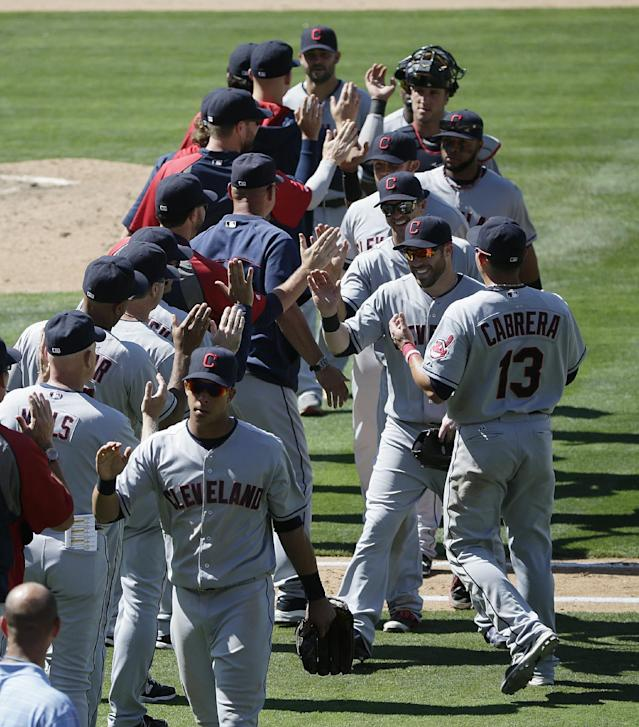 The Cleveland Indians players celebrate their team's 5-4 win against the Los Angeles Dodgers in a baseball game on Wednesday, July 2, 2014, in Los Angeles. (AP Photo/Jae C. Hong)