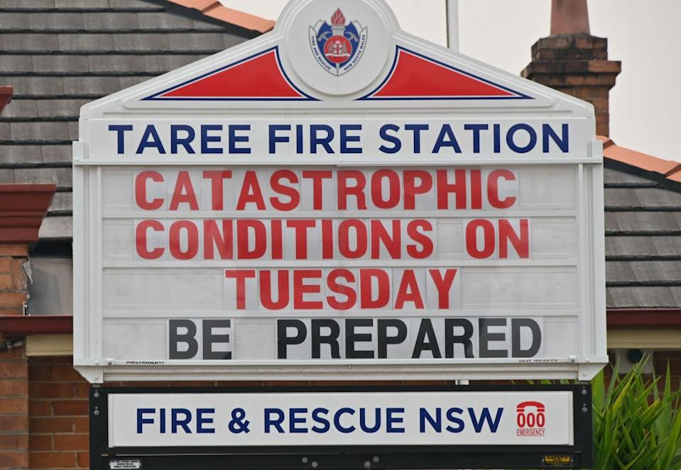 Pictured is a noticeboard outside Taree Fire Station that warns of catastrophic bushfire conditions.