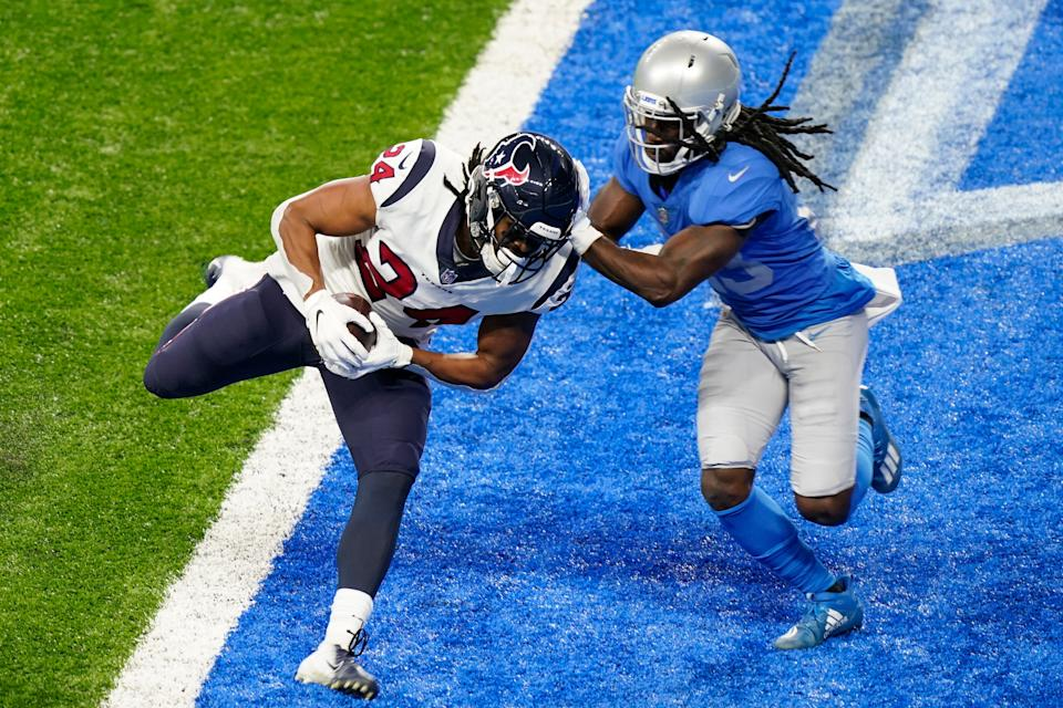 Texans running back C.J. Prosise, defended by Lions cornerback Desmond Trufant runs into the end zone after a 7-yard pass reception for a touchdown during the first half on Thursday, Nov. 26, 2020, at Ford Field.