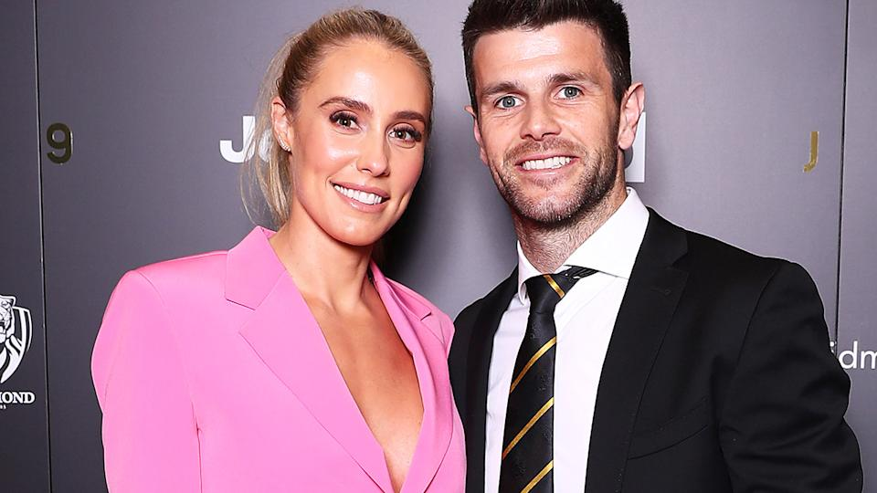 Brooke and Trent Cotchin are pictured posing at the Richmond Tigers best & fairest in 2019.