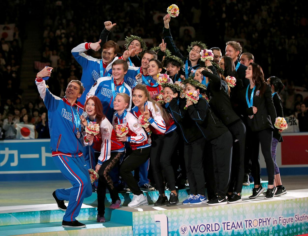 Figure Skating - ISU World Team Trophy -  Award Ceremony - Tokyo, Japan - 22/4/17 - From L-R: Russia's, Japan's and U.S.'s players take selfie after the award ceremony.    REUTERS/Toru Hanai     TPX IMAGES OF THE DAY
