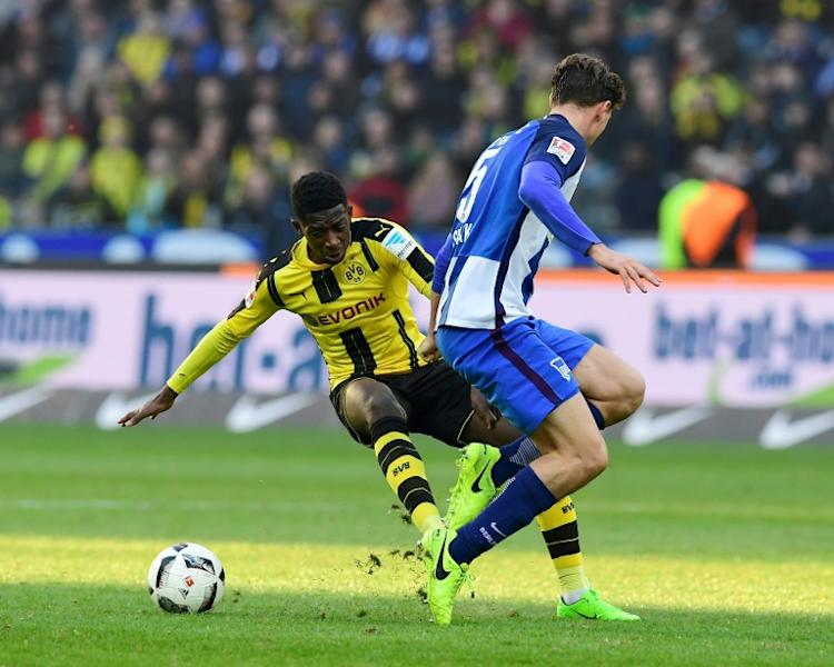Dortmund's midfielder Ousmane Dembele (L) and Hertha Berlin's midfielder Niklas Stark vie for the ball during the German First division Bundesliga football match of Hertha Berlin vs Borussia Dortmund in Berlin, Germany, on March 11, 2017