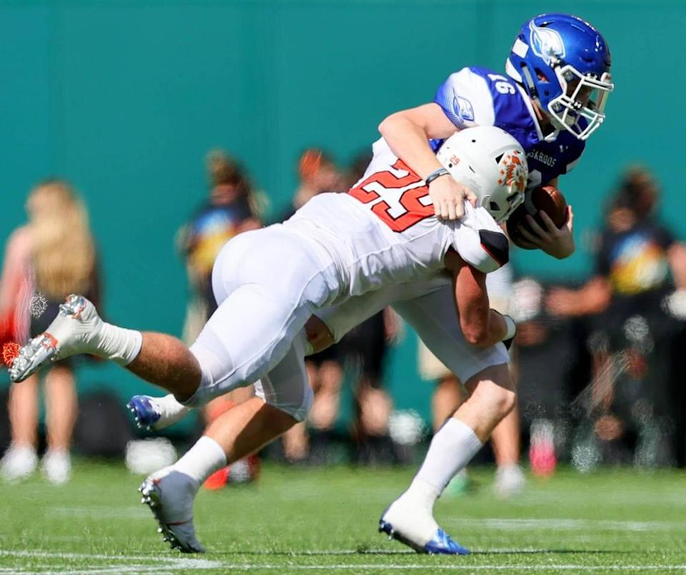 Aledo defensive end Caden Anderson (29) sacks Weatherford quarterback Major Youngblood (16) for a loss during the first half, Saturday afternoon, Sepember 26, 2020 played at Globe Life Park in Arlington, TX (Steve Nurenberg Special to the Star-Telegram)