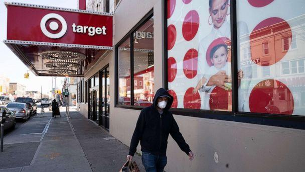 PHOTO: A customer wearing a mask carries his purchases as he leaves a Target store during the coronavirus pandemic, Brooklyn, N.Y., April 6, 2020. (Mark Lennihan/AP, FILE)