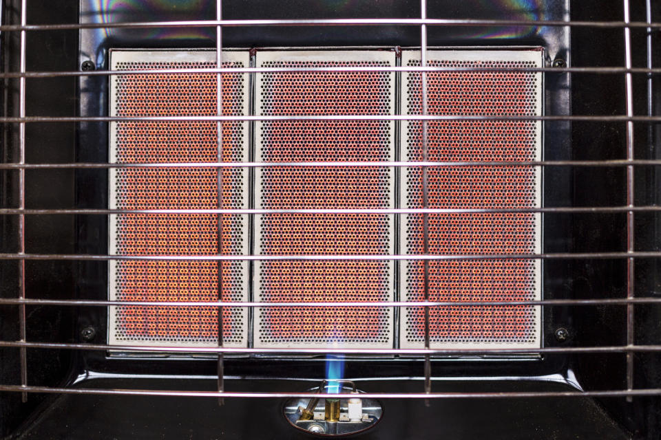 A close-up of an unflued household gas heater with flame and heat panels. Source: Getty, file.