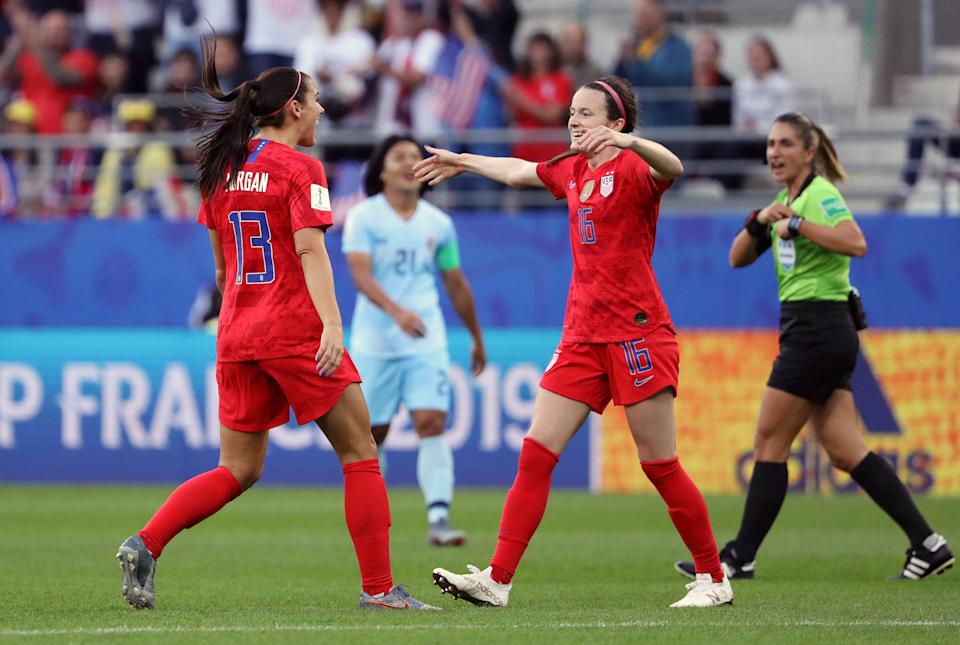REIMS, FRANCE - JUNE 11: Rose Lavelle of the USA celebrates with teammate Alex Morgan after scoring her team's second goal during the 2019 FIFA Women's World Cup France group F match between USA and Thailand at Stade Auguste Delaune on June 11, 2019 in Reims, France. (Photo by Robert Cianflone/Getty Images)