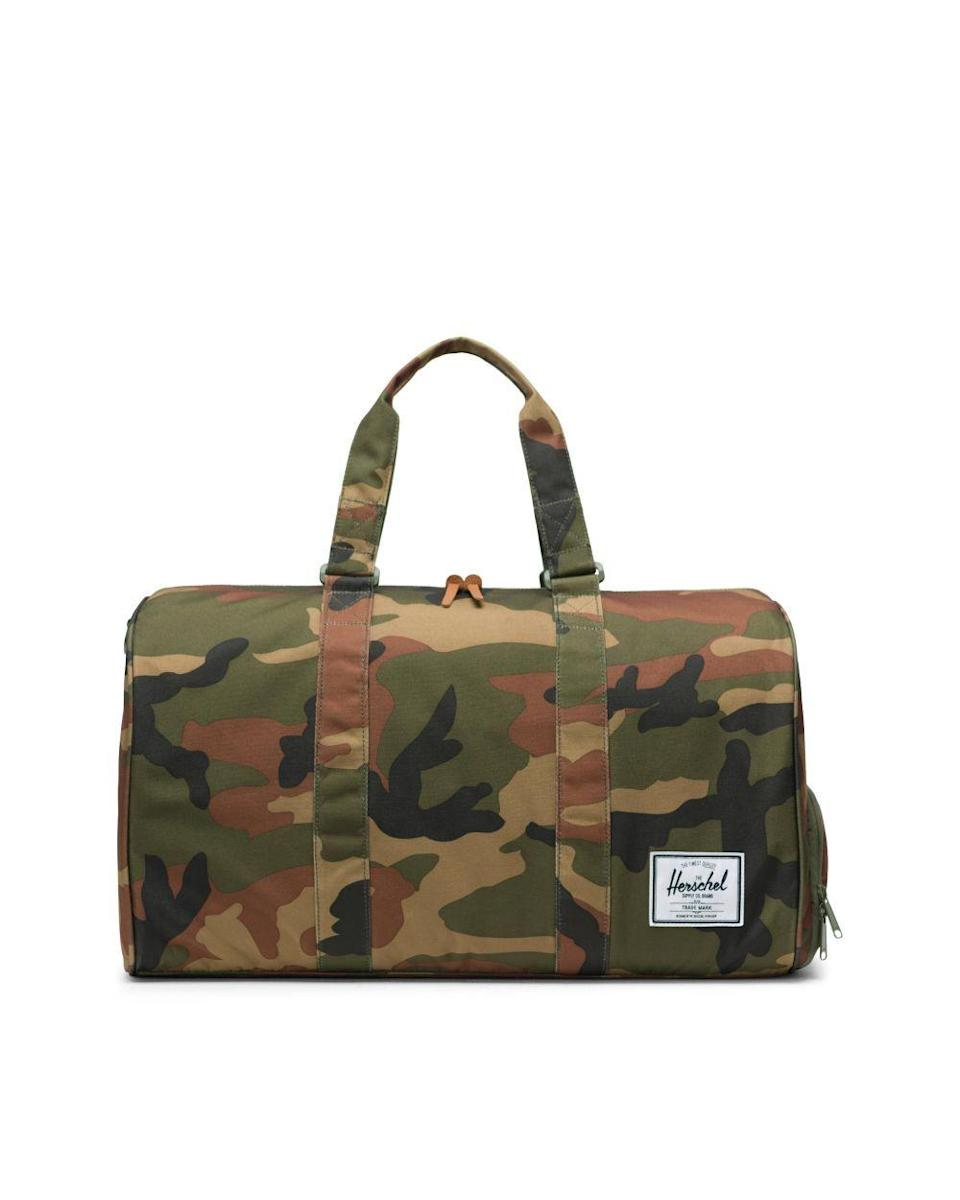 """<p><strong>herschel supply co.</strong></p><p>herschel.com</p><p><strong>$14.99</strong></p><p><a href=""""https://go.redirectingat.com?id=74968X1596630&url=https%3A%2F%2Fherschel.com%2Fshop%2Fduffles%2Fnovel-duffle%3Fv%3D10026-00699-OS&sref=https%3A%2F%2Fwww.thepioneerwoman.com%2Ffashion-style%2Fg32388887%2Fbest-weekender-bags%2F"""" rel=""""nofollow noopener"""" target=""""_blank"""" data-ylk=""""slk:Shop Now"""" class=""""link rapid-noclick-resp"""">Shop Now</a></p><p>Herschel bags come in so many colors and patterns, but this one packs two patterns into one! The outside sports a bold camo print and the lining has a classic stripe. It also has a hidden shoe pocket to keep your soles from touching your threads. </p>"""