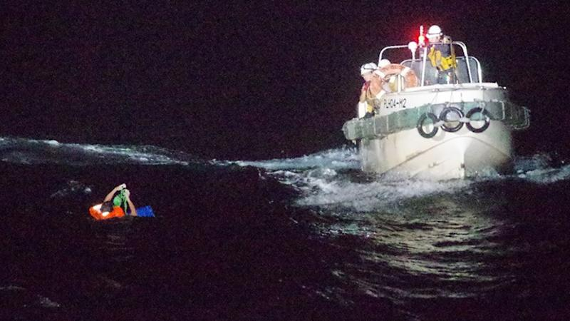 A crew member from the capsized Gulf Livestock 1 ship being rescued