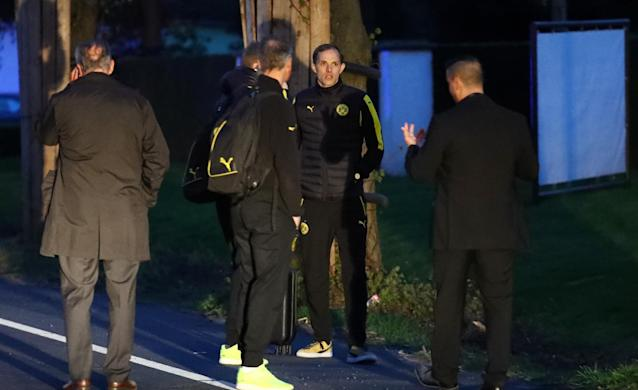 <p>Borussia Dortmund coach Thomas Tuchel is seen by the team bus after an explosion near their hotel before the game </p>