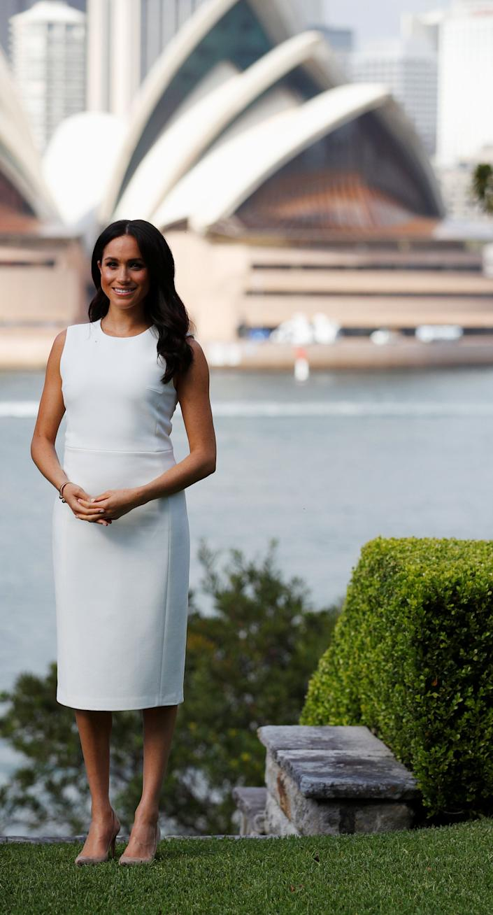 On October 16, the Duchess of Sussex kick-started her debut royal tour in a dress by Australian designer Karen Gee. [Photo: Getty]