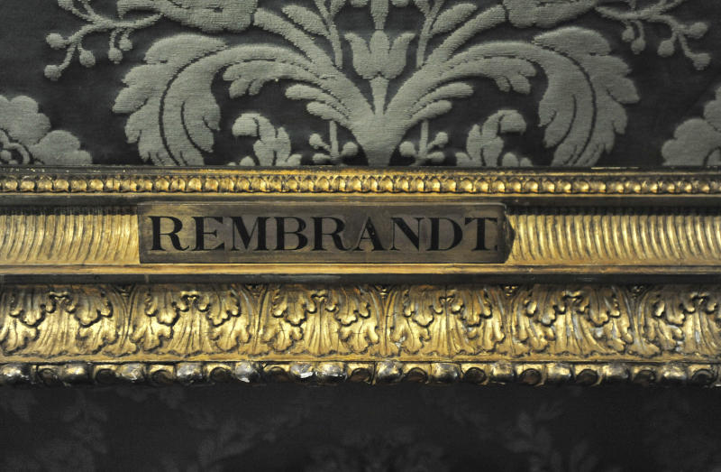 """FILE - In this Thursday, March 11, 2010 file photo, a plaque marks the empty frame from which thieves cut Rembrandt's """"The Storm on the Sea of Galilee,"""" which remains on display at the Isabella Stewart Gardner Museum in Boston. It is one of 13 works stolen by burglars from the museum in the early hours of March 18, 1990.The FBI said Monday, March 18, 2013, it believes it knows the identities of the thieves who stole the art. Richard DesLauriers, the FBI's special agent in charge in Boston, says the thieves belong to a criminal organization based in New England the mid-Atlantic states. (AP Photo/Josh Reynolds, File)"""
