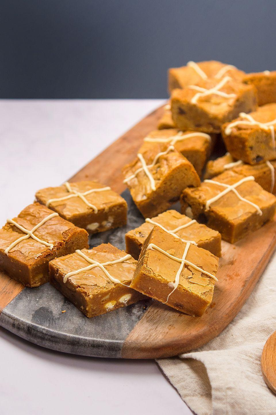 """<p>Blondies are a great thing to bake, and these Easter versions are packed with the fabulous spied and dried fruits of the humble hot cross bun.</p><p><strong><br>Recipe: <a href=""""https://www.goodhousekeeping.com/uk/food/recipes/a26699101/hot-cross-bun-blondies/"""" rel=""""nofollow noopener"""" target=""""_blank"""" data-ylk=""""slk:Hot cross bun blondies"""" class=""""link rapid-noclick-resp"""">Hot cross bun blondies</a></strong></p>"""