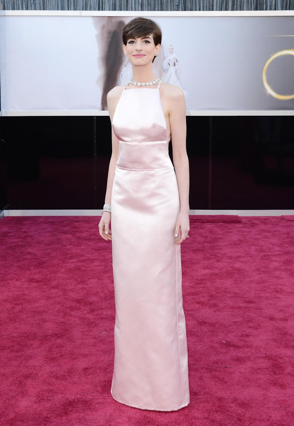 Hathaway hit headlines in 2013 when she wore this pale pink Prada dress to the Oscars – and not because of how beautifully simplistic it was. The American actress was supposed to be wearing a Valentino gown but switched to the Prada at the last moment because another actress was set to wear a very similar look. Can't say we mind: the Prada looked sensational on the petite star.