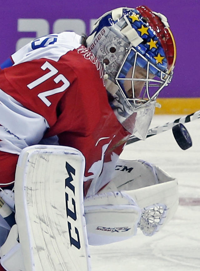 Russia goaltender Sergei Bobrovski blocks a shot on goal by the USA in the first period of a men's ice hockey game at the 2014 Winter Olympics, Saturday, Feb. 15, 2014, in Sochi, Russia. (AP Photo/Julio Cortez)
