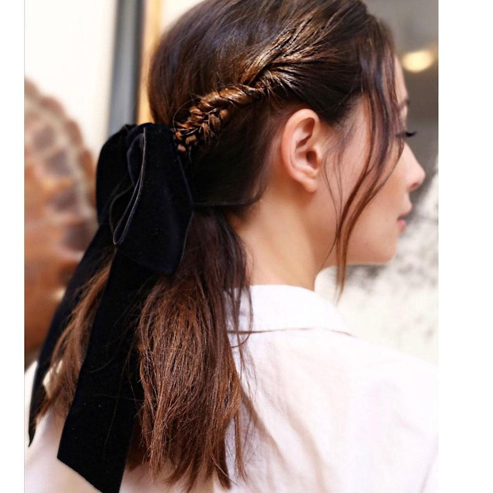 Always a good idea, a thick side braid is even better when paired with a low pony and a velvet ribbon.
