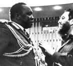 <p>Cuban Prime Minister Fidel Castro talks with President Idi Amin of Uganda during a break in the closing session of the fourth summit meeting of the Non-Aligned countries at the Palais des Nationes conference hall in Algiers, Sept. 9, 1977. (AP Photo) </p>