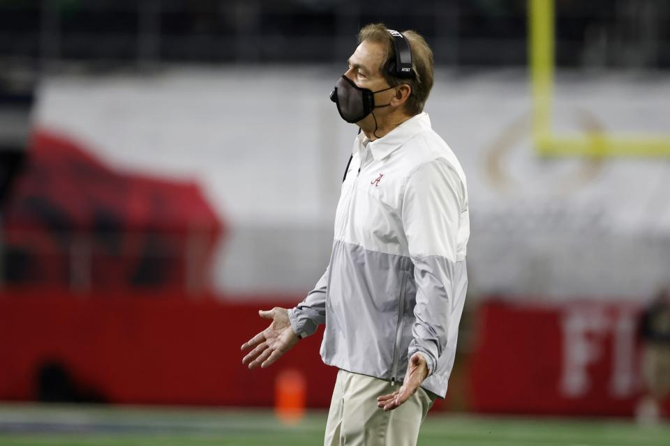 Alabama head coach Nick Saban gestures as he watches play against Notre Dame in the first half of the Rose Bowl NCAA college football game in Arlington, Texas, Friday, Jan. 1, 2021. (AP Photo/Michael Ainsworth)
