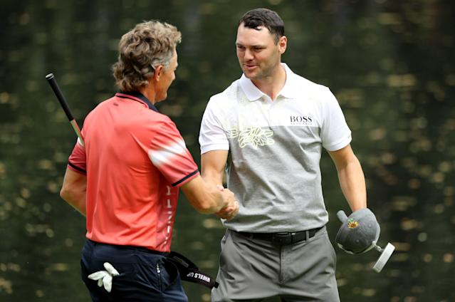 German golfers Bernhard Langer (L) and Martin Kaymer shake hands after the par 3 contest held on the final day of practice for the 2018 Masters golf tournament at Augusta National Golf Club in Augusta, Georgia, U.S. April 4, 2018. REUTERS/Lucy Nicholson