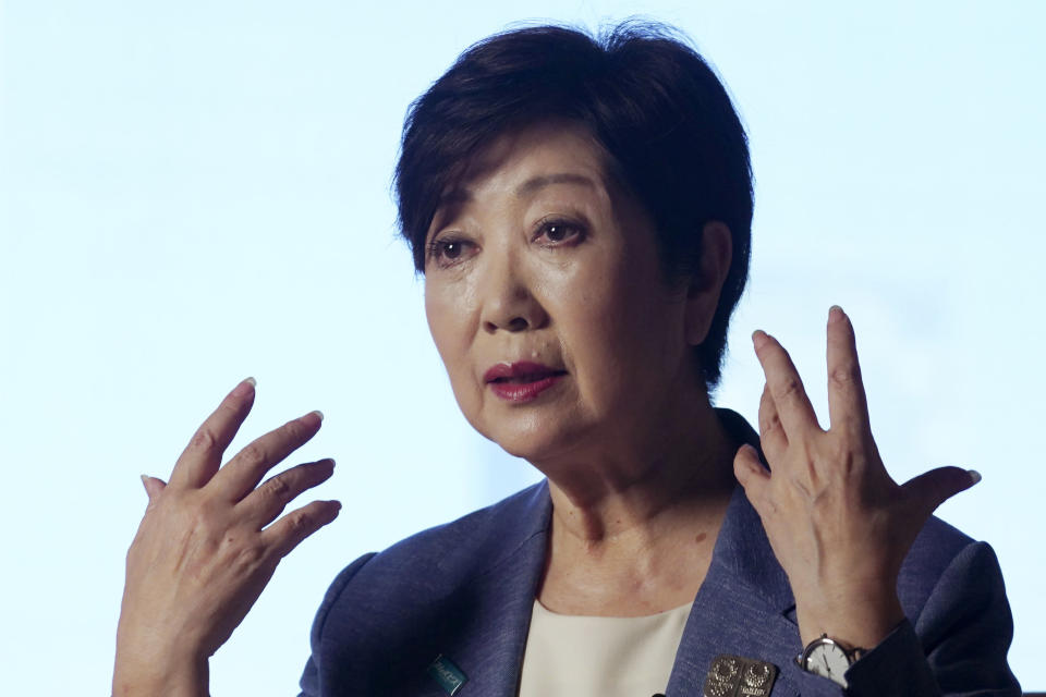 Tokyo Gov. Yuriko Koike gestures while speaking during an exclusive interview with The Associated Press at her office of the Tokyo Metropolitan Government Building in Tokyo Wednesday, June 17, 2020, ahead of a two-week campaigning for the election. A political go-getter, Koike even had the coronavirus crisis turn in her favor. And she repeatedly upstaged Prime Minister Shinzo Abe by taking more proactive steps ahead of him, gaining public support. Timing is also on her side now, she is cruising to a certain victory in the July 5 election for her second term as head of the Japanese capital. (AP Photo/Eugene Hoshiko)