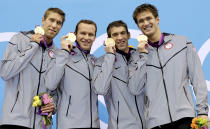 <p>Matthew Grevers, Brendan Hansen, Michael Phelps and Nathan Adrian hold their gold medals after winning the 4 X 100-meter medley relay event in London on Aug. 4, 2012. (Michael Sohn/AP)</p>