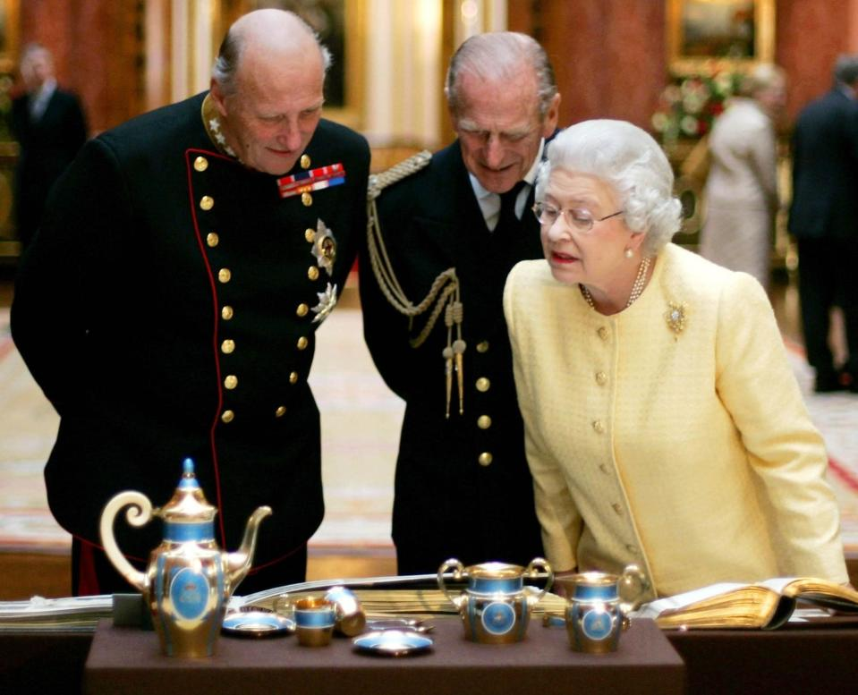 FILE - In this Tuesday Oct. 25, 2005, file photo, Britain's Queen Elizabeth II, right, Prince Philip, centre, and the King Harald V, of Norway view an exhibition of Norwegian items from the Royal Collection in the Picture Gallery at Buckingham Palace in London. Prince Philip's life spanned just under an entire century of European history. His genealogy was just as broad, with Britain's longest-serving consort linked by blood and marriage to most of the continent's royal houses. (AP Photo/Matt Dunham, File)