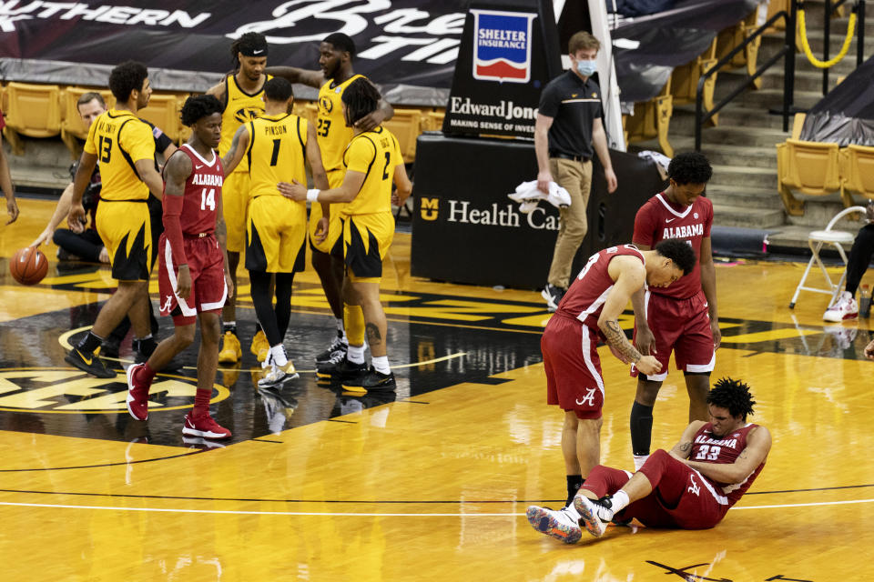 Alabama's James Rojas, right grimaces after being fouled during the second half of an NCAA college basketball game against Missouri, Saturday, Feb. 6, 2021, in Columbia, Mo. Missouri won 68-65.(AP Photo/L.G. Patterson)