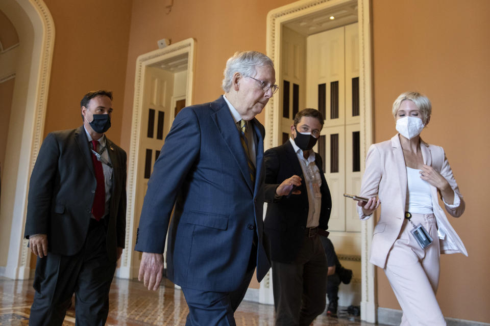Senate Minority Leader Mitch McConnell, R-Ky., speaks to reporters amid continuing talks around the $1 trillion bipartisan infrastructure bill on Capitol Hill in Washington, Tuesday, Aug. 3, 2021. (AP Photo/Amanda Andrade-Rhoades)