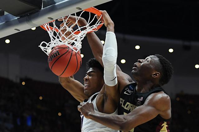 <p>Rui Hachimura #21 of the Gonzaga Bulldogs dunks the ball against Mfiondu Kabengele #25 of the Florida State Seminoles during the 2019 NCAA Men's Basketball Tournament West Regional at Honda Center on March 28, 2019 in Anaheim, California. (Photo by Harry How/Getty Images) </p>