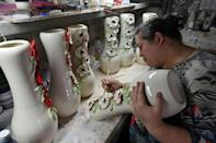 Maryna Novikova's ceramics workshop was thriving -- until the coronavirus pandemic hit, forcing staff layoffs and lower wages