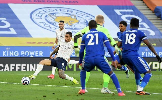 Gabriel Jesus, left, scores Manchester City's second goal in their 2-0 Premier League win against Leicester at the King Power Stadium