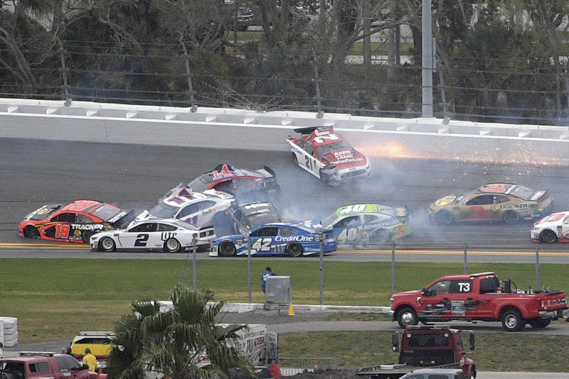 Paul Menard (21) spins in Turn 3, starting a multi-car pileup during the NASCAR Clash auto race at Daytona International Speedway Sunday, Feb. 10, 2019, in Daytona Beach, Fla. (AP Photo/Phelan M. Ebenhack)