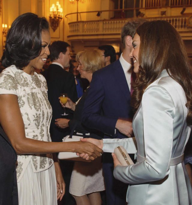 US first lady Michelle Obama, left, meets the Duchess of Cambridge during a reception at Buckingham Palace in London, to welcome Heads of State and Heads of Government to the UK before they travel to the Olympic Stadium for the Opening Ceremony of the London 2012 Olympic Games, Friday July 27, 2012. (AP Photo / Dominic Lipinski)