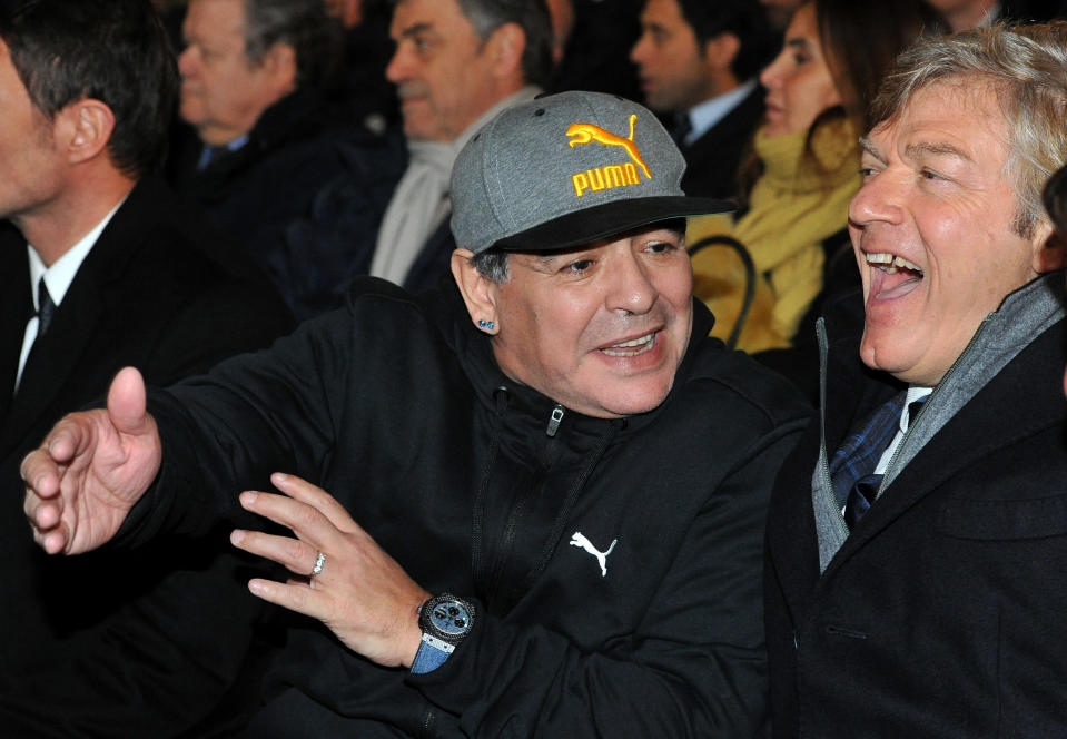 Diego Maradona, left, gestures as he stands next to Italian former soccer player Giancarlo Antognoni in Florence, Italy, on Jan. 17, 2017. Diego Maradona has died. The Argentine soccer great was among the best players ever and who led his country to the 1986 World Cup title before later struggling with cocaine use and obesity. He was 60. (Jennifer Lorenzini/LaPresse via AP)