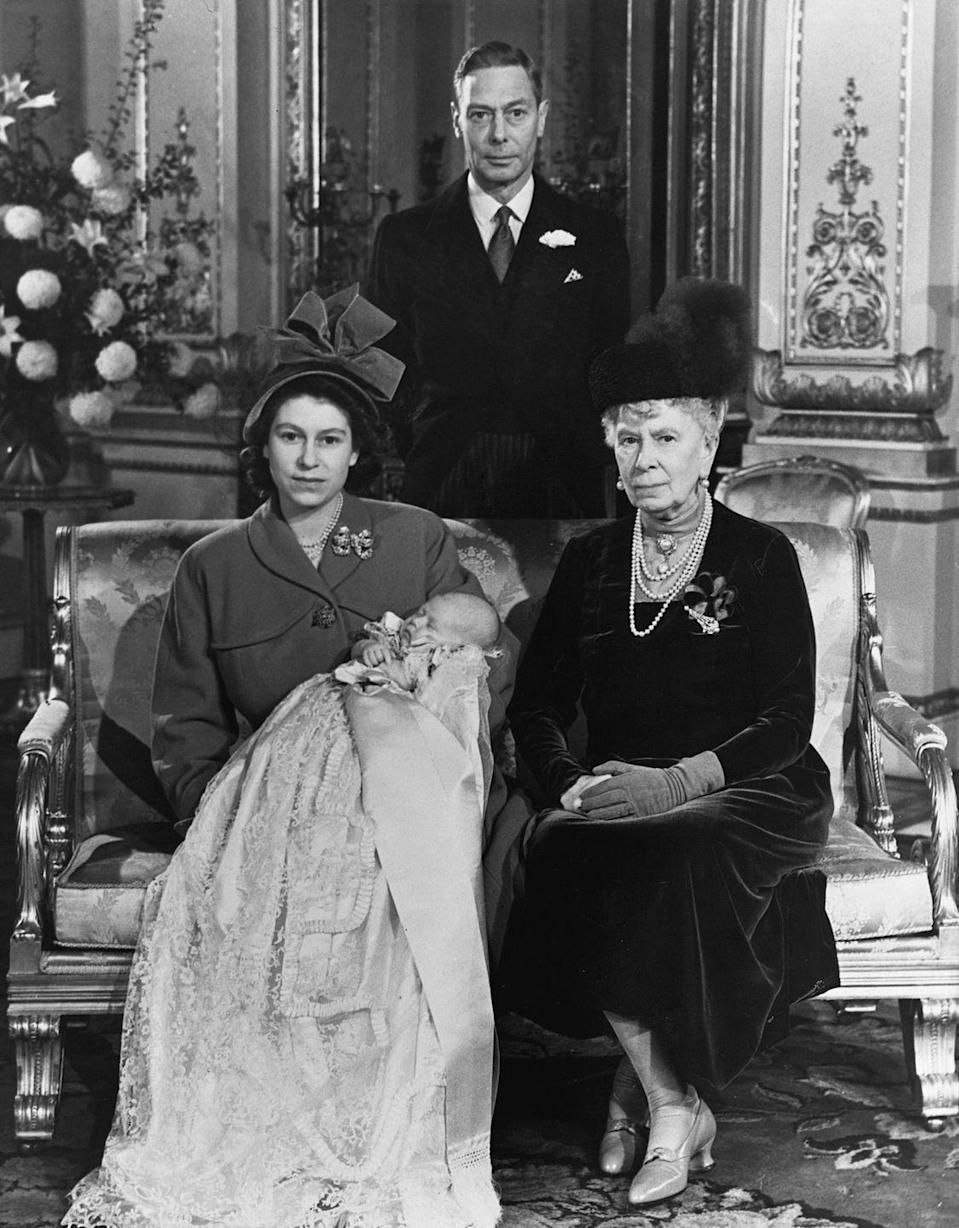 <p>Elizabeth poses with her Grandmother, Queen Mary, and her father, King George VI and her first child, Prince Charles, on his christening day. </p>
