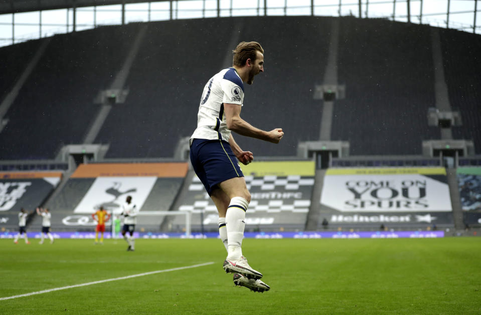 Tottenham's Harry Kane celebrates after scoring his side's opening goal during the English Premier League soccer match between Tottenham Hotspur and West Bromwich Albion at the Tottenham Hotspur Stadium in London, Sunday, Feb. 7, 2021. (AP Photo/Matt Dunham, Pool)