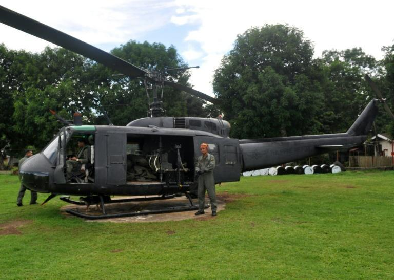 A Philippine military helicopter is loaded with body bags of soldiers killed in a clash with members of the Abu Sayyaf group, in the southern island of Mindanao in 2013