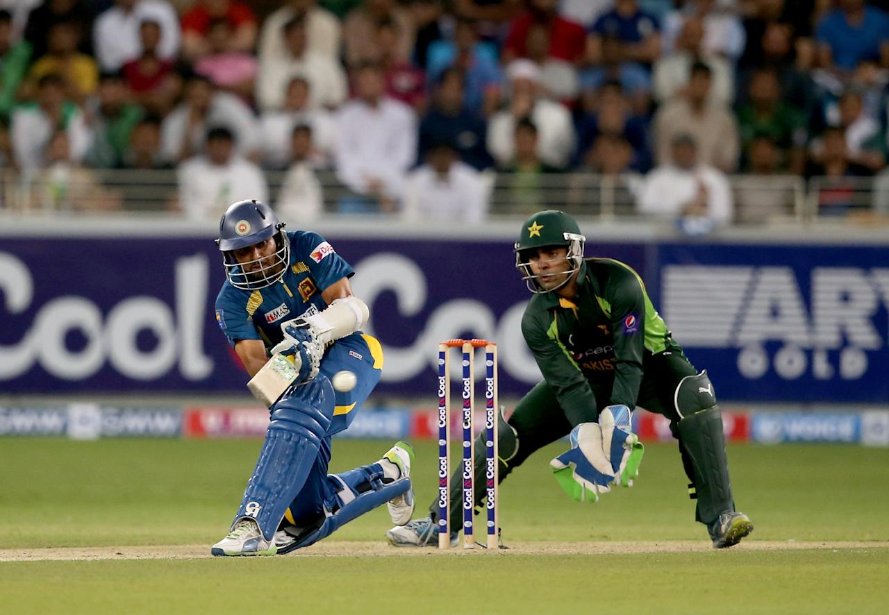 DUBAI, UNITED ARAB EMIRATES - DECEMBER 13:  TM Dilshan of Sri Lanka bats during the second Twenty20 International match between Pakistan and Sri Lanka at Dubai Sports City Cricket Stadium on December 13, 2013 in Dubai, United Arab Emirates.  (Photo by Francois Nel/Getty Images)