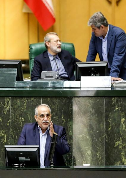 Masoud Karbasian (bottom) addresses Iran's parliament on August 26, 2018, before losing a confidence vote which saw him stripped of his position as economy minister