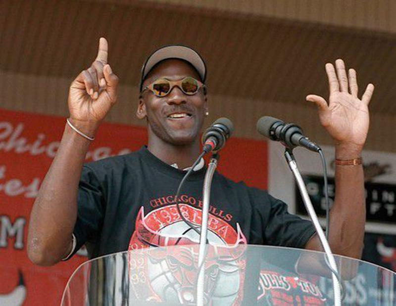 Michael Jordan holds up six fingers for each championship of the Chicago Bulls dynasty, on June 16, 1998. (Chuck Berman/Chicago Tribune/Tribune News Service via Getty Images)
