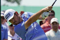 Louis Oosthuizen, of South Africa, tees off on the 11th hole during the third round of the Memorial golf tournament, Saturday, June 5, 2021, in Dublin, Ohio. (AP Photo/Darron Cummings)