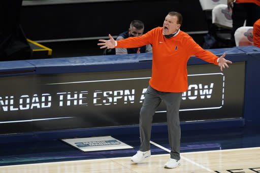 Illinois coach Brad Underwood argues a call during the second half of the team's NCAA college basketball game against Baylor, Wednesday, Dec. 2, 2020, in Indianapolis. (AP Photo/Darron Cummings)