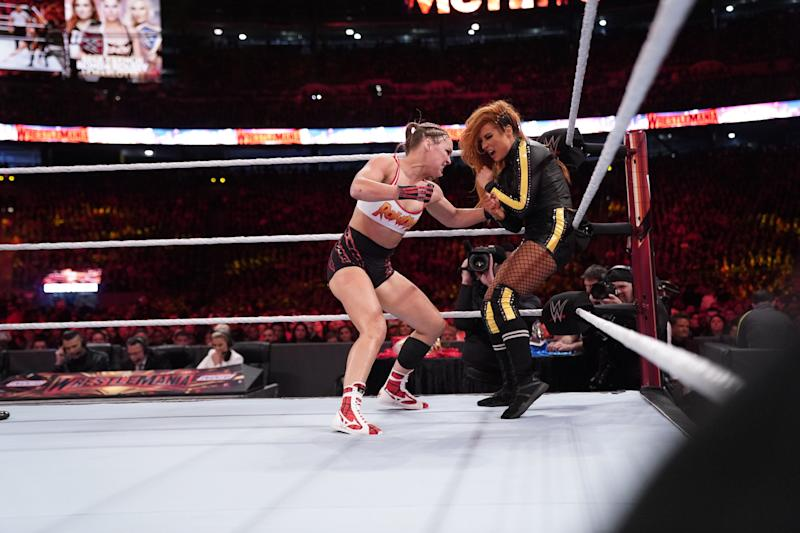 Ronda Rousey punches Becky Lynch during the main event of WrestleMania 35 at MetLife Stadium in East Rutherford, N.J. (WWE)