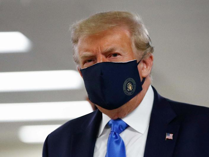 President Donald Trump wears a face mask as he visits Walter Reed National Military Medical Centre in Bethesda, Md., 11 July 2020: AP