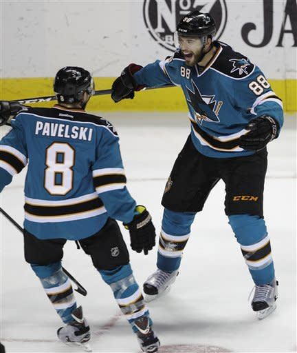 San Jose Sharks defenseman Brent Burns (88) is congratulated by center Joe Pavelski (8) after scoring past the Phoenix Coyotes in the first period of an NHL hockey game in San Jose, Calif., Saturday, March 24, 2012. (AP Photo/Paul Sakuma)