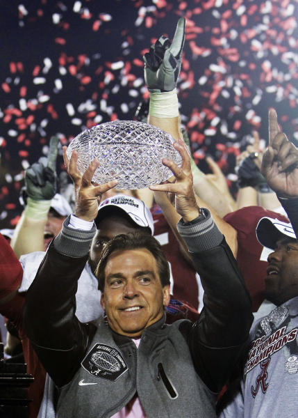 FILE - In this Jan. 7, 2010, file photo, Alabama head coach Nick Saban holds up the trophy after defeating Texas 37-21 in the BCS national championship NCAA college football game in Pasadena, Calif. The D word - as in dynasty - is off-limits around Alabama. But if Saban's Crimson Tide can beat No. 1 Notre Dame to become the first team to win consecutive BCS championships and three national titles in four years, Alabama will lay claim to one of the sport's great runs. (AP Photo/Marcio Jose Sanchez, File)
