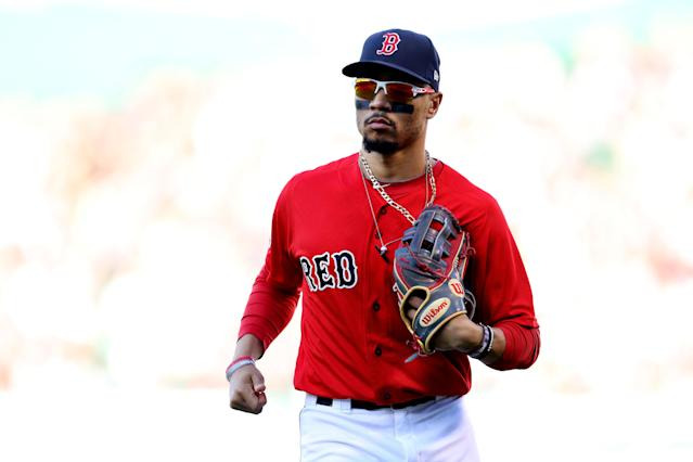"Superstar outfielder <a class=""link rapid-noclick-resp"" href=""/mlb/players/9552/"" data-ylk=""slk:Mookie Betts"">Mookie Betts</a> would head from the <a class=""link rapid-noclick-resp"" href=""/mlb/teams/boston/"" data-ylk=""slk:Boston Red Sox"">Boston Red Sox</a> to the <a class=""link rapid-noclick-resp"" href=""/mlb/teams/la-dodgers/"" data-ylk=""slk:Los Angeles Dodgers"">Los Angeles Dodgers</a> if the latest version of the blockbuster trade is indeed made official. (Maddie Meyer/Getty Images)"