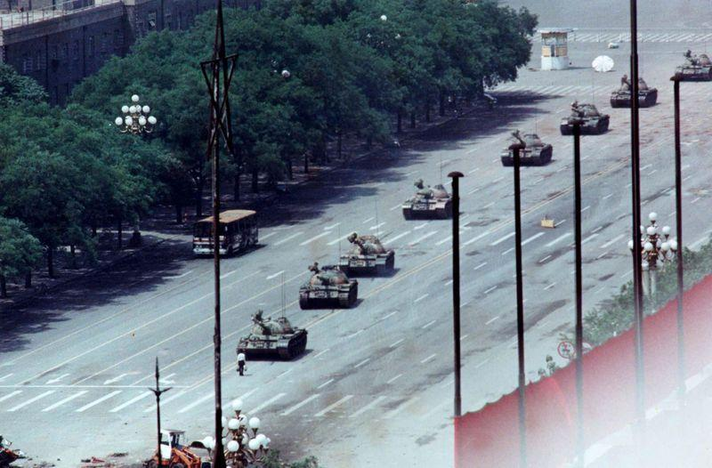 File photo shows a man standing passively to block a column of army tanks on Changan Avenue east of Tiananmen Square in Beijing