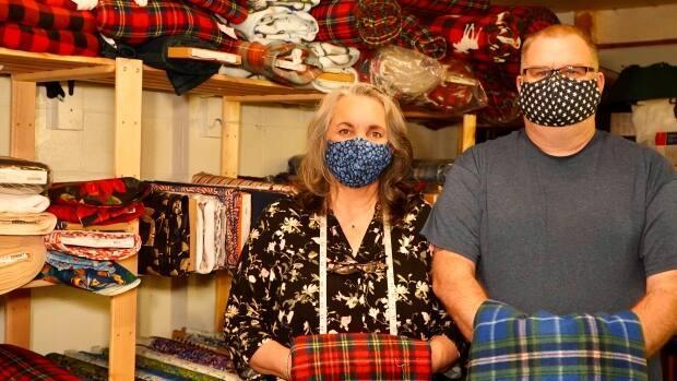 Sherrie and Dale Kearney of the Maritime Tartan Company switched the focus of the business to help people affordably get face masks when they were in short supply at the start of the COVID-19 pandemic. (Craig Paisley/CBC - image credit)